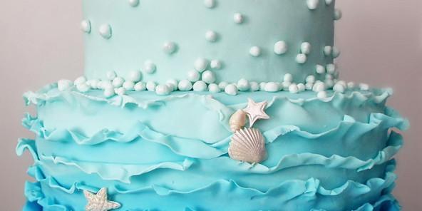 torta pasta di zucchero conchiglie e onde